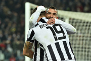 Leonardo Bonucci (L) of Juventus FC celebrates a goal with team mate Carlos Tevez during the Serie A match between Juventus FC and AC Milan at Juventus Arena on February 7, 2015 in Turin, Italy.