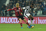 Paul Pogba (R) of Juventus FC competes with Keisuke Honda of AC Milan during the Serie A match between Juventus FC and AC Milan at Juventus Arena on February 7, 2015 in Turin, Italy.
