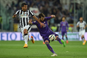 Carlos Tevez (L) of Juventus FC competes with Jose Basanta of ACF Fiorentina during the Serie A match between Juventus FC and ACF Fiorentina at Juventus Arena on April 29, 2015 in Turin, Italy.