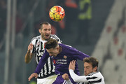 Federico Bernardeschi (C) of ACF Fiorentina clashes with Giorgio Chiellini (L) and Claudio Marchisio of Juventus FC during the Serie A match betweeen Juventus FC and ACF Fiorentina at Juventus Arena on December 13, 2015 in Turin, Italy.