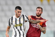 Simone Muratore (L) of Juventus competes with Davide Santon of AS Roma during the Serie A match between Juventus and  AS Roma at  on August 1, 2020 in Turin, Italy.