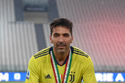 Gianluigi Buffon of Juventus FC celebrates with the trophy after the Serie A match between Juventus and  AS Roma at Allianz Stadium on August 1, 2020 in Turin, Italy.