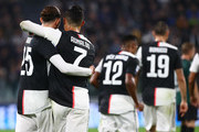 Cristiano Ronaldo #7 of Juventus FC celebrates with his team-mate Adrien Rabiot (L) after scoring the opening goal during the Serie A match between Juventus and Bologna FC at Allianz Stadium on October 19, 2019 in Turin, Italy.