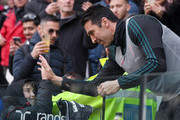 Gianluigi Buffon of Juventus greets a young fan  during the Serie A match between Juventus and Cagliari Calcio at Allianz Stadium on January 6, 2020 in Turin, Italy.