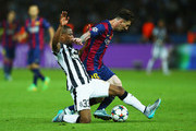 Lionel Messi of Barcelona is tackled by Patrice Evra of Juventus during the UEFA Champions League Final between Juventus and FC Barcelona at Olympiastadion on June 6, 2015 in Berlin, Germany.