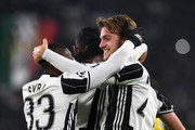 Daniele Rugani (R) of Juventus celebrates a goal with team mate Patrice Evra during the UEFA Champions League Group H match between Juventus and GNK Dinamo Zagreb at Juventus Stadium on December 7, 2016 in Turin.