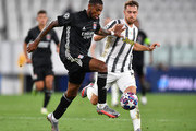 Jeff Reine-Adelaide of Olympique Lyon is challenged by Aaron Ramsey of Juventus during the UEFA Champions League round of 16 second leg match between Juventus and Olympique Lyon at Allianz Stadium on August 07, 2020 in Turin, Italy.