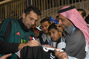 Gianluigi Buffon of Juventus signing autographs and taking selfie before the training session on December 22, 2019 in Riyadh, Saudi Arabia.