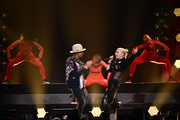 Recording artists Pharrell Williams (L) and Gwen Stefani perform onstage during KIIS FM's Jingle Ball 2014  powered by LINE at Staples Center on December 5, 2014 in Los Angeles, California.