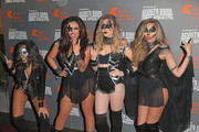Jesy Nelson, Leigh-Anne Pinnock, Perrie Edwards and Jade Thirlwall from Little Mix attend the KISS FM Haunted House Party at SSE Arena on October 29, 2015 in London, England.