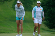 Suzann Pettersen of Norway (L) prepares  to putt as Inbee Park of South Korea looks on at the third green during the first round of the KPMG Women's PGA Championship held at Westchester Country Club on June 11, 2015 in Harrison, New York.