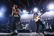 Sameer Gadhia (L) and Payam Doostzadeh of Young the Giant perform on stage during  KROQ Absolut Almost Acoustic Christmas at The Forum on December 9, 2018 in Inglewood, California.