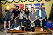 (L-R) KROQ Radio Host Kevin Ryder interviews Sameer Gadhia, Jacob Tilley, Payam Doostzadeh, Francois Comtois and Eric Cannata of Young the Giant during an interview at KROQ Absolut Almost Acoustic Christmas at The Forum on December 9, 2018 in Inglewood, California.