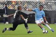 Itumeleng Khune of the Kaizer Cheifs tries to save the ball from Kelvin Etuhu of Manchester City during the 2009 Vodacom Challenge match between Kaizer Chiefs and Manchester City from the Absa Stadium on July 21, 2009 in Durban, South Africa.