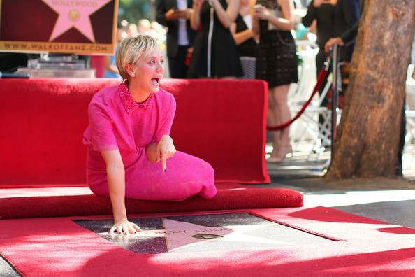 Actress Kaley Cuoco poses with her star on the Hollywood Walk of Fame on October 29, 2014 in Hollywood, California.