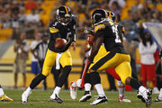Bruce Gradkowski #5 of the Pittsburgh Steelers hands the ball off against the Kansas City Chiefs in the second half during the game on August 24, 2013 at Heinz Field in Pittsburgh, Pennsylvania.