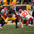 Kelcie McCray Photos - Markus Wheaton #11 of the Pittsburgh Steelers carries the ball in front of Kelcie McCray #24 and Kurt Coleman #27 of the Kansas City Chiefs during the first quarter at Heinz Field on December 21, 2014 in Pittsburgh, Pennsylvania. - Kelcie McCray Photos - 13 of 18