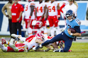 Ryan Tannehill #17 of the Tennessee Titans runs with the ball for a first down during the final minutes of the fourth quarter against the Kansas City Chiefs at Nissan Stadium on November 10, 2019 in Nashville, Tennessee. Tennessee defeats Kansas City 35-32.