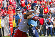Quarterback Ryan Tannehill #17 of the Tennessee Titans fumbles the ball after being hit by Chris Jones #95 of the Kansas City Chiefs during the first half at Nissan Stadium on November 10, 2019 in Nashville, Tennessee.