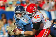 Emmanuel Ogbah #90 of the Kansas City Chiefs sacks quarterback Ryan Tannehill #17 of the Tennessee Titans during the first half at Nissan Stadium on November 10, 2019 in Nashville, Tennessee.