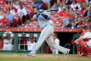 Salvador Perez #13 of the Kansas City Royals hits a RBI double in the first inning against the Cincinnati Reds at Great American Ball Park on September 26, 2018 in Cincinnati, Ohio.