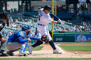 Miguel Cabrera #24 of the Detroit Tigers swings and makes contact for an RBI in the first inning against the Kansas City Royals during a MLB game at Comerica Park on April 22, 2018 in Detroit, Michigan.