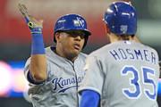 Salvador Perez #13 of the Kansas City Royals celebrates with teammate Eric Hosmer #35 after hitting a game tying two run home run in the ninth inning of the game against the Detroit Tigers on September 18, 2015 at Comerica Park in Detroit, Michigan.
