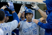 Raul Ibanez #18 of the Kansas City Royals is congratulated by teammates after hitting a home run against the Oakland Athletics during the fifth inning at O.co Coliseum on August 1, 2014 in Oakland, California.