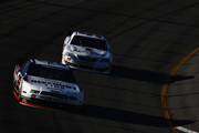 Brad Keselowski, driver of the #22 Discount Tire Ford, leads Alex Bowman, driver of the #99 St. Jude Children's Research Hospital Toyota, during the NASCAR Nationwide Series 13th Annual Kansas Lottery 300 at Kansas Speedway on October 5, 2013 in Kansas City, Kansas.