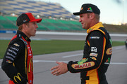 Jamie McMurray, driver of the #1 McDonald's Trick. Treat. Win! Chevrolet, talks with Clint Bowyer, driver of the #14 Dekalb Ford, during qualifying for the Monster Energy NASCAR Cup Series Hollywood Casino 400 at Kansas Speedway on October 19, 2018 in Kansas City, Kansas.
