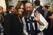 "Kaia Gerber and Takashi Murakami attend the ""Tribute to the Karl Lagerfeld: The White Shirt Project"" exhibition as part of Paris Fashion Week in Paris on September 25, 2019."