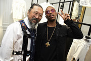 "Takashi Murakami and Lil Buck attend the ""Tribute to the Karl Lagerfeld: The White Shirt Project"" exhibition as part of Paris Fashion Week in Paris on September 25, 2019."