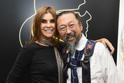 "Carine Roitfeld and Takashi Murakami attend the ""Tribute to the Karl Lagerfeld: The White Shirt Project"" exhibition as part of Paris Fashion Week in Paris on September 25, 2019."