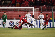 Leo Silva of Kashima Antlers and Obafemi Martins of Shanghai Shenhua compete for the ball during the AFC Champions League Group H match between Kashima Antlers and Shanghai Shenhua at Kashima Soccer Stadium on February 14, 2018 in Kashima, Ibaraki, Japan.