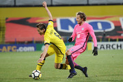 Kei Koizumi #8 of Kashiwa Reysol competes for the ball against Diego Forlan #18 of Kitchee SC during the AFC Champions League Group E match between Kashiwa Reysol and Kitchee at Sankyo Frontier Kashiwa Stadium on March 6, 2018 in Kashiwa, Chiba, Japan.