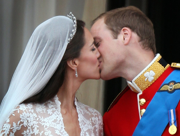 Best of the Royal Wedding [royal wedding,kiss,red,interaction,tradition,wedding dress,romance,bride,forehead,bridal clothing,bridal accessory,prince william,best,royal highnesses,duchess,second,cambridge,london,balcony,kiss]
