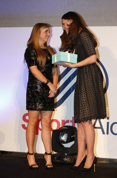 Kate Middleton Catherine, Duchess of Cambridge, patron of SportsAid charity, presents the charity's this year's One-to-Watch Award to shooter Amber Hill, 16, (L) at the SportsBall, the charity's annual gala dinner at Victoria Embankment Gardens on November 28, 2013  in London, England.