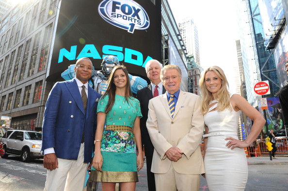 Regis Philbin and a Robot Ring the NYSE Opening Bell [cleatus the robot,yellow,event,tourism,photography,vehicle,vacation,car,city,regis philbin,opening bell,gus johnson,georgie thompson,bill raftery,katie nolan,robot ring,nasdaq marketsite,nyse]
