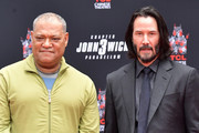 Laurence Fishburne (L) and Keanu Reeves attend a handprint ceremony honoring Reeves at the TCL Chinese Theatre IMAX forecourt on May 14, 2019 in Hollywood, California.