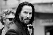 (EDITORS NOTE; Image has been converted to black and white) Keanu Reeves attends 'Keanu Reeves places his hand prints in cement' at TCL Chinese Theatre IMAX on May 14, 2019 in Hollywood, California.
