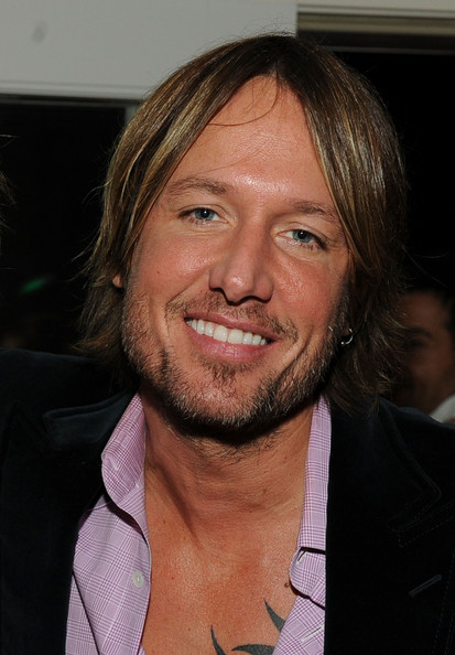 keith urban haircut. keith urban tattoo on chest.