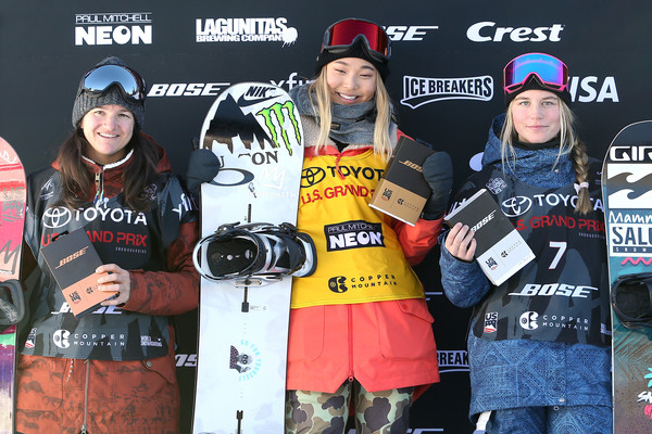 Chloe Kim, Maddie Mastro, and Kelly Clark pose at a Snowboarding event