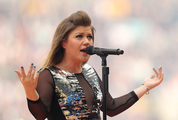 2011 NRL Grand Final - Sea Eagles v Warriors [music artist,singing,singer,performance,entertainment,microphone,performing arts,song,event,music,xx kelly clarkson,australia,sydney,anz stadium,warriors,sea eagles,nrl grand final,match]