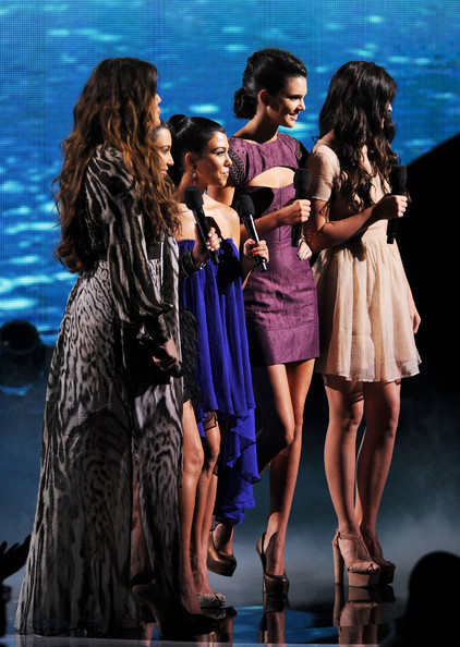 Kendall Jenner (L-R) Khloe Kardashian, Kim Kardashian, Kendall Jenner, and Kylie Jenner onstage during the 2011 Teen Choice Awards held at the Gibson Amphitheatre on August 7, 2011 in Universal City, California.