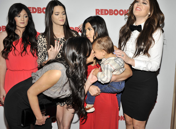 Kendall Jenner Kim Kardashian kisses nephew Mason Disick as Redbook celebrates first ever family issue with the Kardashians held at The Sunset Tower Hotel on April 11, 2011 in West Hollywood, California.