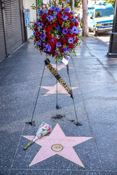 Flowers Placed On The Hollywood Walk Of Fame Star Of Kenny Rogers