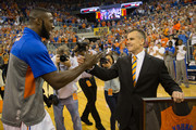 Patric Young #4 shakes hands with head coach Billy Donovan of the Florida Gators while being honored before the game against the Kentucky Wildcats at the Stephen C. O'Connell Center on March 8, 2014 in Gainesville, Florida.