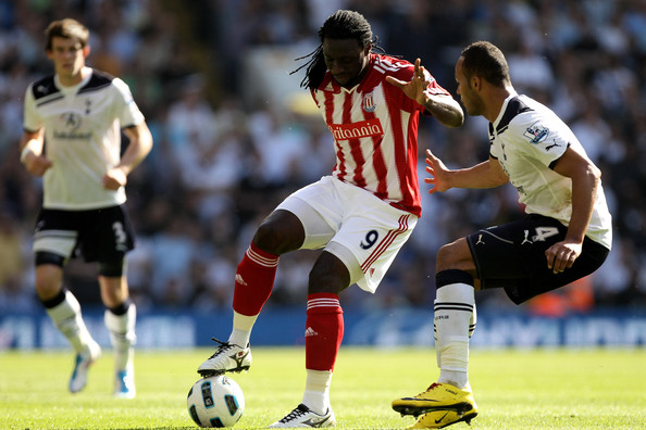 Kenwyne Jones Kenwyne Jones of Stoke is challenged byYounes Kaboul of Spurs during the Barclays Premier League match between Tottenham Hotspur and Stoke City at White Hart Lane on April 9, 2011 in London, England.