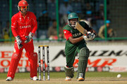 Collins Obuya of Kenya bats, watched by keeper Ashish Bagai of Canada during the ICC Cricket World Cup group A match between Canada and Kenya at Feroz Shah Kotla stadium on March 7, 2011 in Delhi, India.