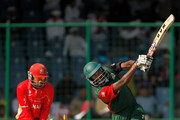 Collins Obuya of Kenya bats is bowled by Harvir Baidwan of Canada during the ICC Cricket World Cup group A match between Canada and Kenya at Feroz Shah Kotla stadium on March 7, 2011 in Delhi, India.